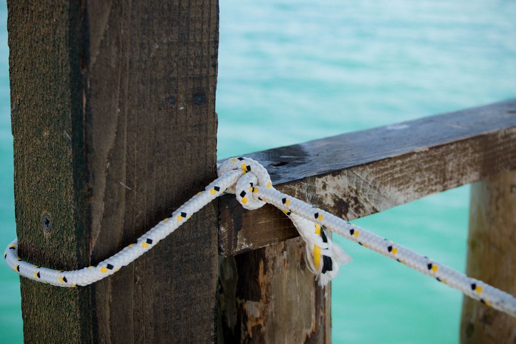 Tied rope on sea background