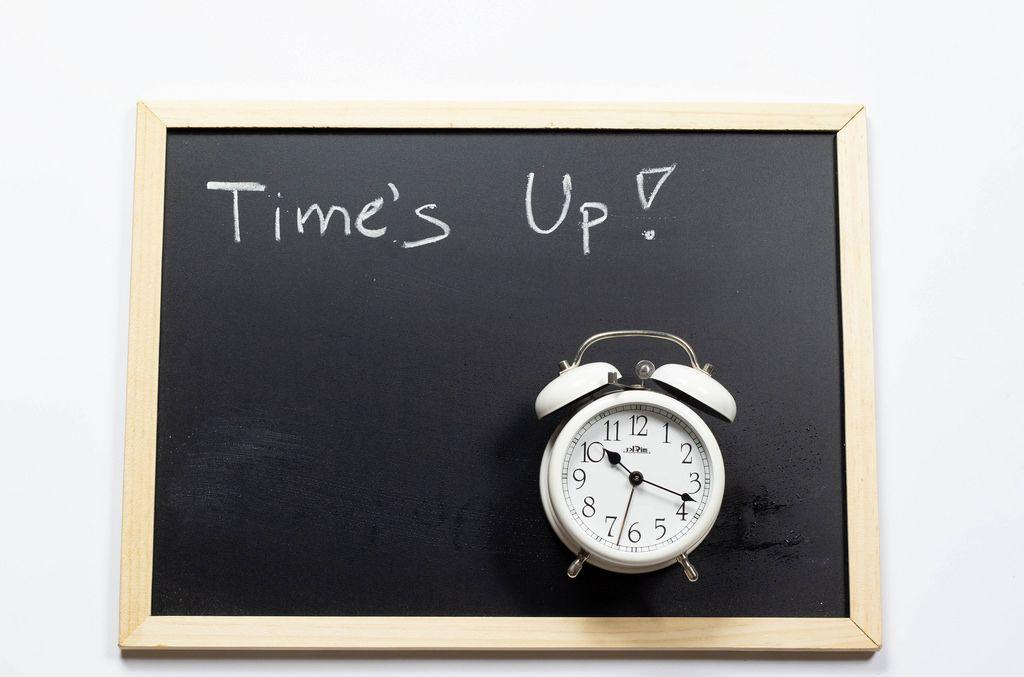 Time's up written on a black chalkboard