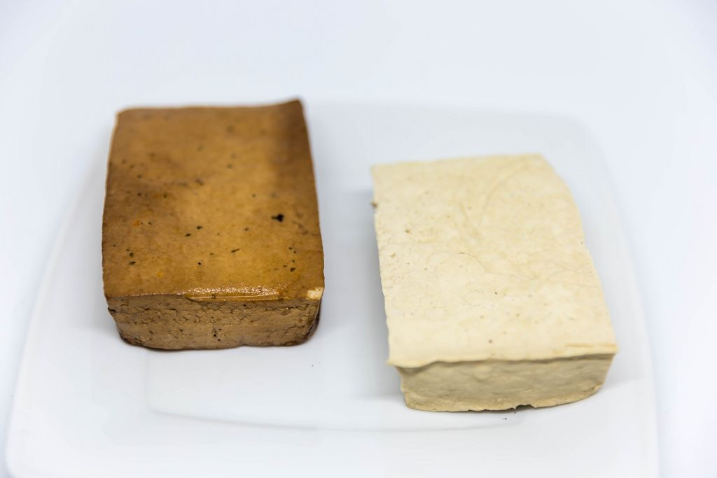 Tofu and smoked tofu on a white plate