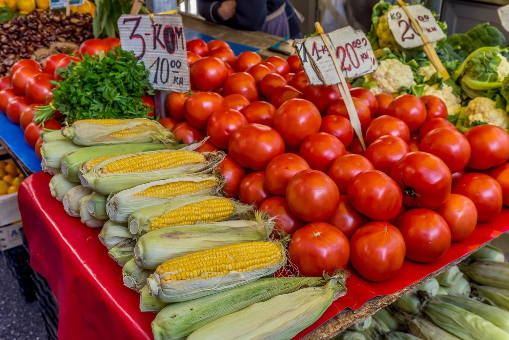 Tomatos and corn on marketplace