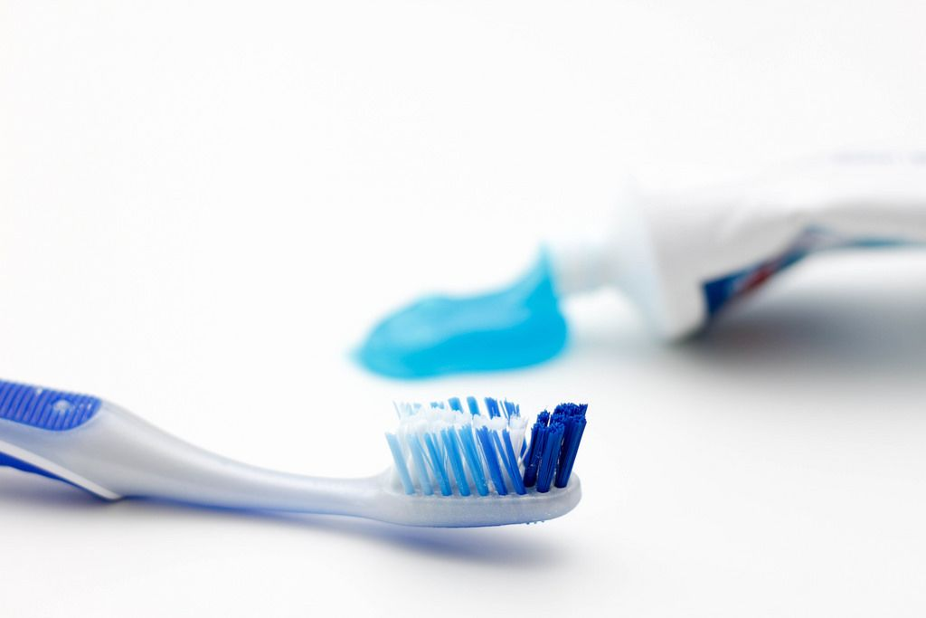 Toothbrush with Paste in the Background