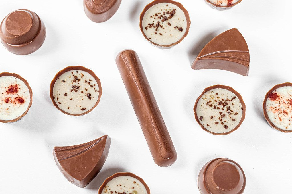 Top view assorted chocolates on a white background (Flip 2019)