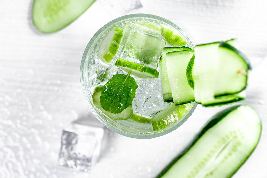 Top view cooling cucumber drink with ice cubes