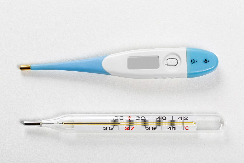 Top view mercury and electric thermometer on a white background
