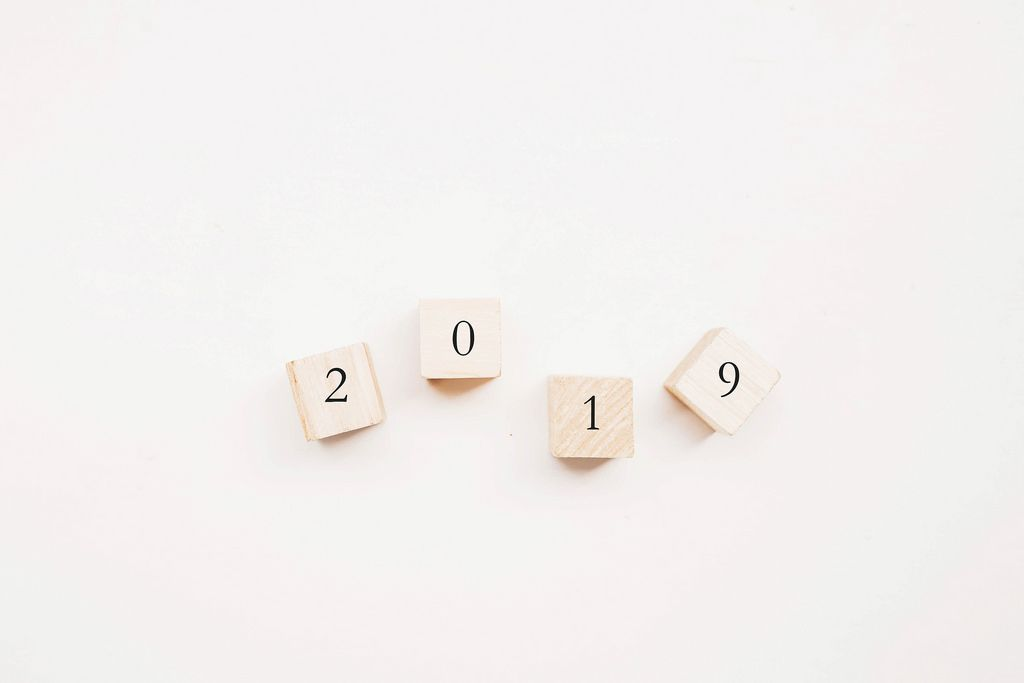 Top view of 2019 written on wooden cubes. New year concept.