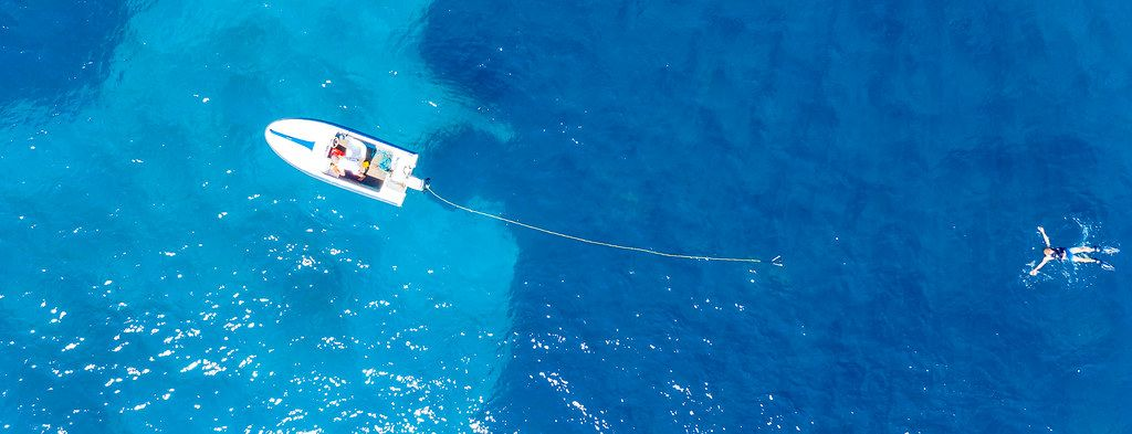 Top view of a failed attempt of water skiing in the deep blue sea of Argolic Gulf