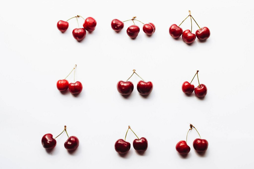 Top view of cherries on white background