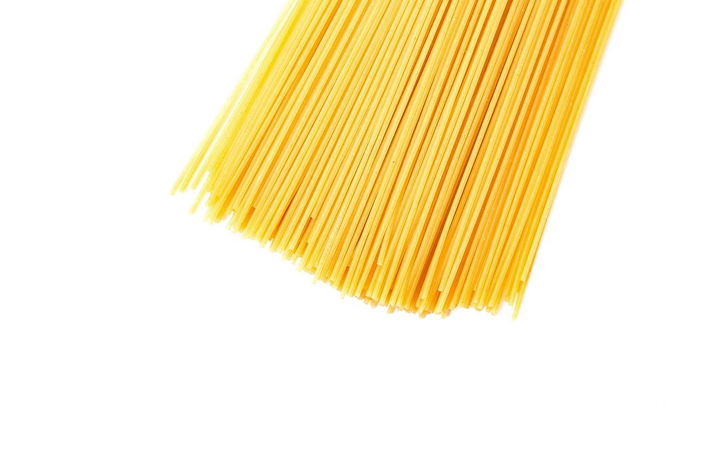 Top view of dry spaghetti pasta on white background (Flip 2019) (Flip 2019) Flip 2019