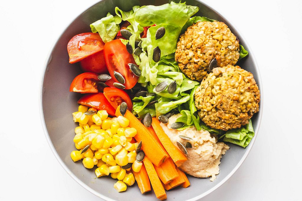 Top view of falafel buddha bowl with veggies