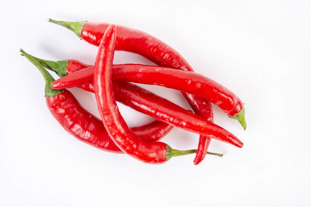 Top view of Fresh Red Hot Chilli Peppers (Flip 2019)