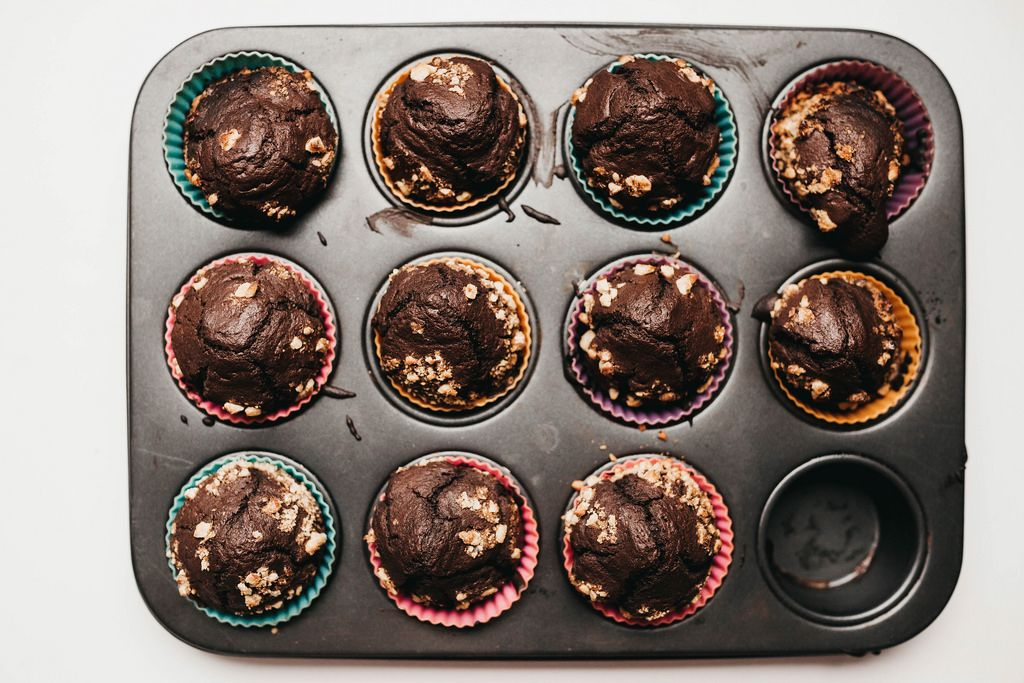 Top view of freshly baked chocolate muffins on muffin pan