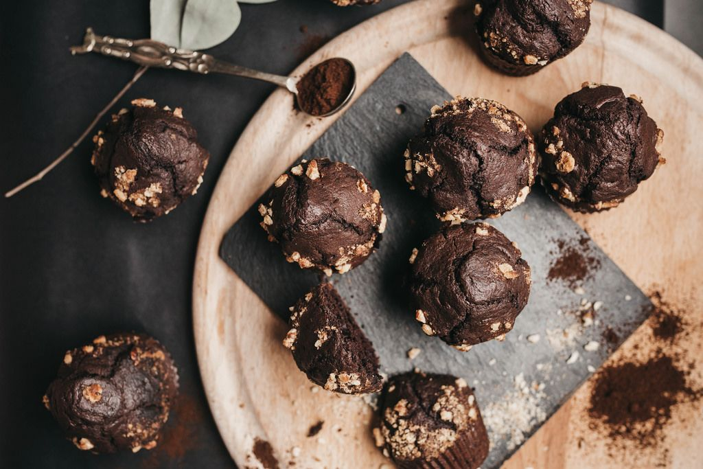 Top view of homemade chocolate muffins on wooden board. Food styling
