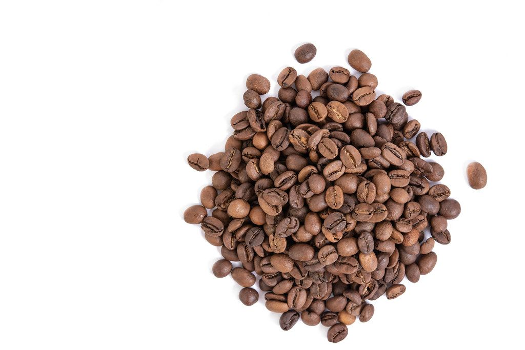 Top view of Raw Coffee isolated above white background