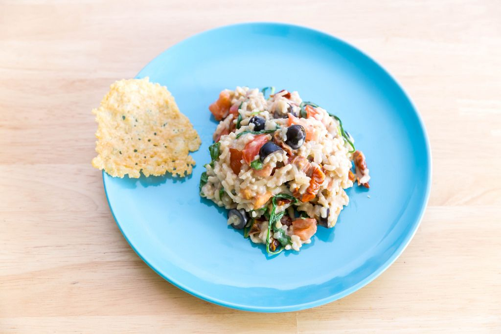 Top view of risotto with dried tomatoes by Hellofresh