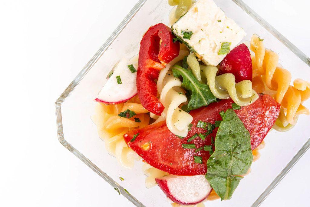 Top view of Tomato Radishes Rukola and Cheese salad