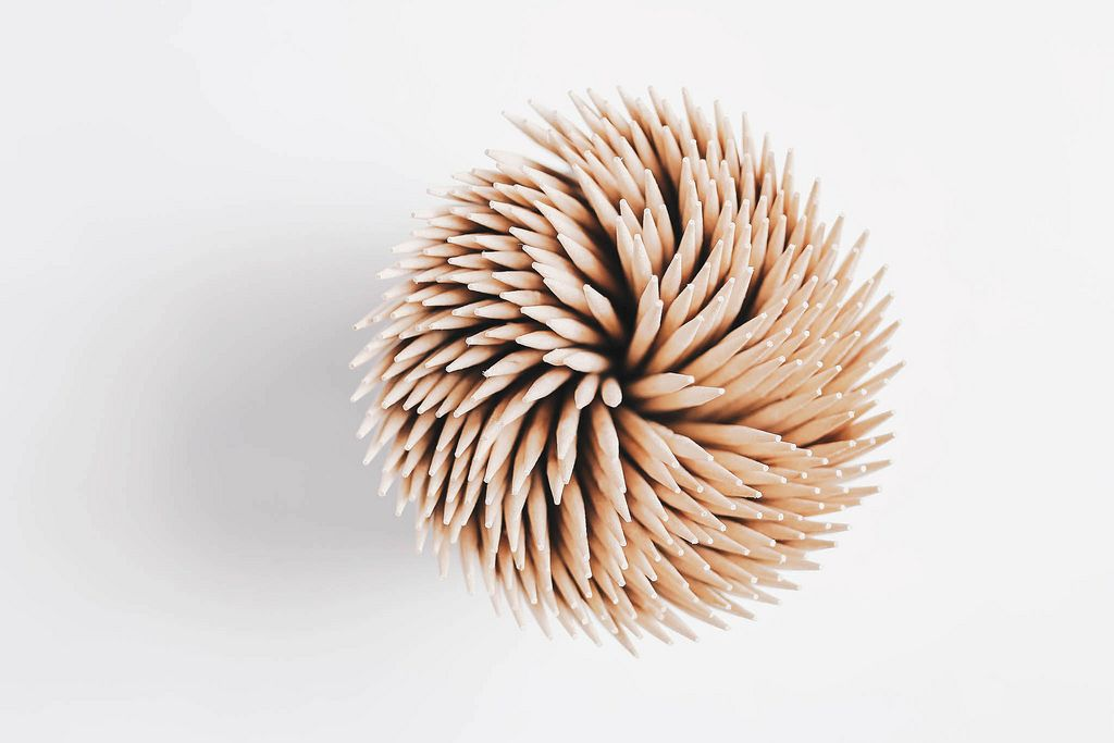 Top view of toothpicks on white background