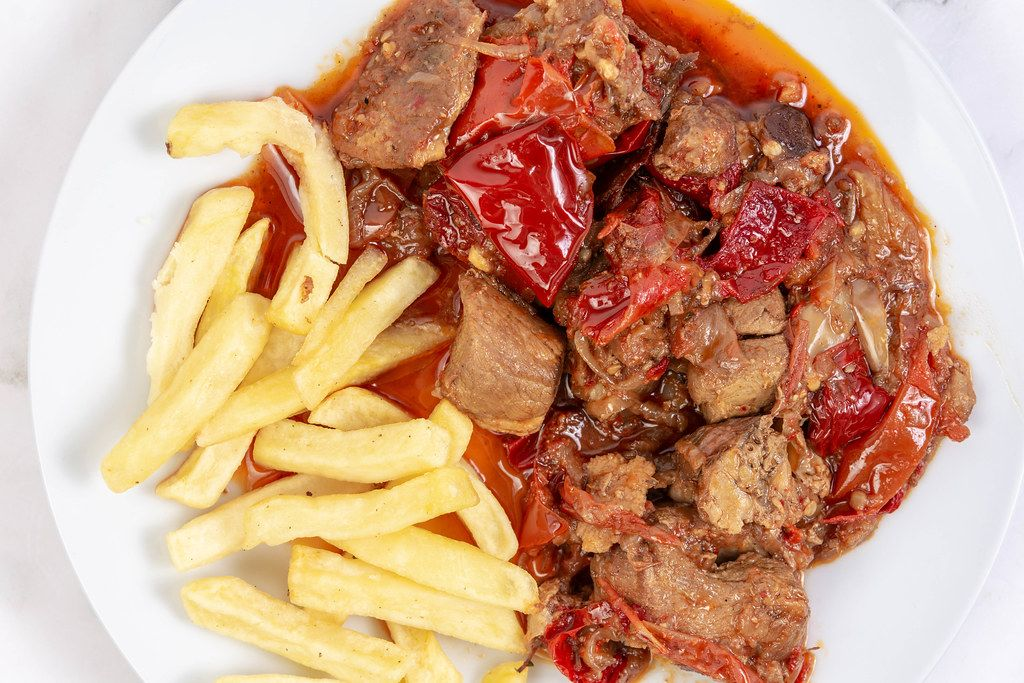 Top view of Traditinal meal Muckalica with Pork Meat and French Fries
