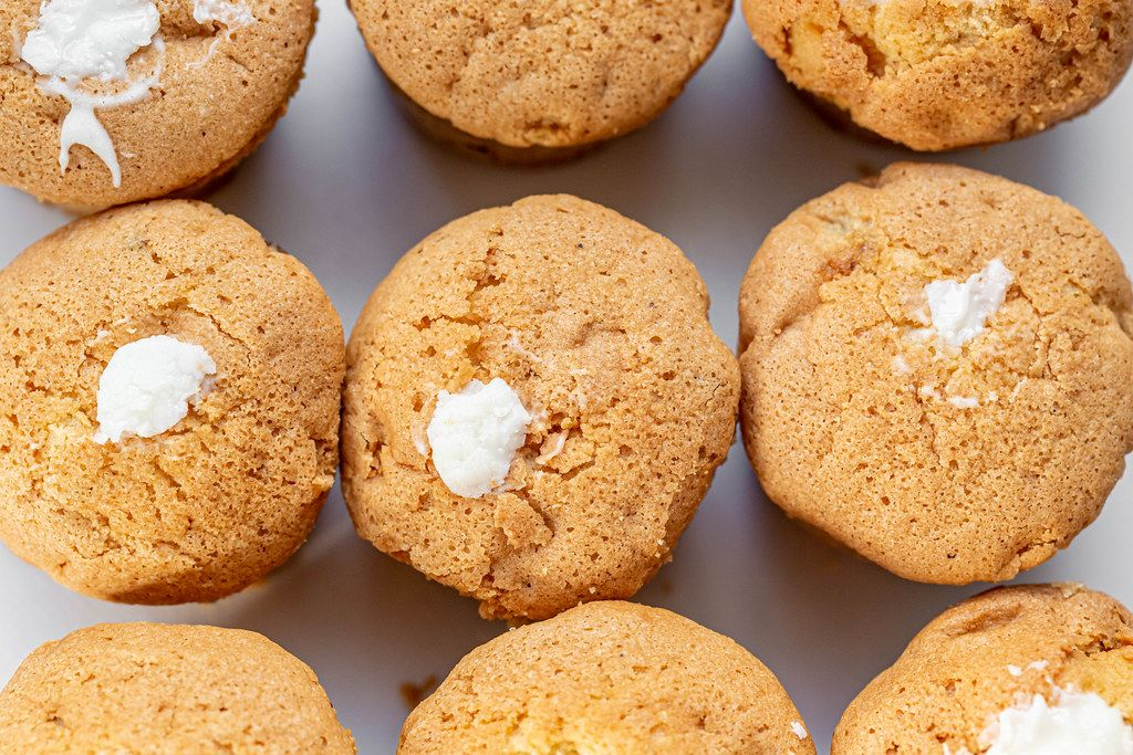 Top view of white cream cupcakes
