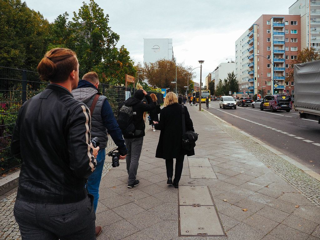 Tourists and photographers walking with cameras on the streets of Berlin.jpg