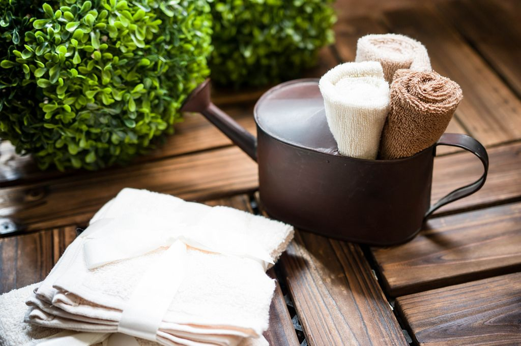 Towel rolls in watering can