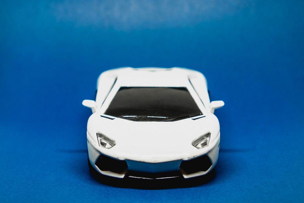 Toy car isolated on blue background (Flip 2019)