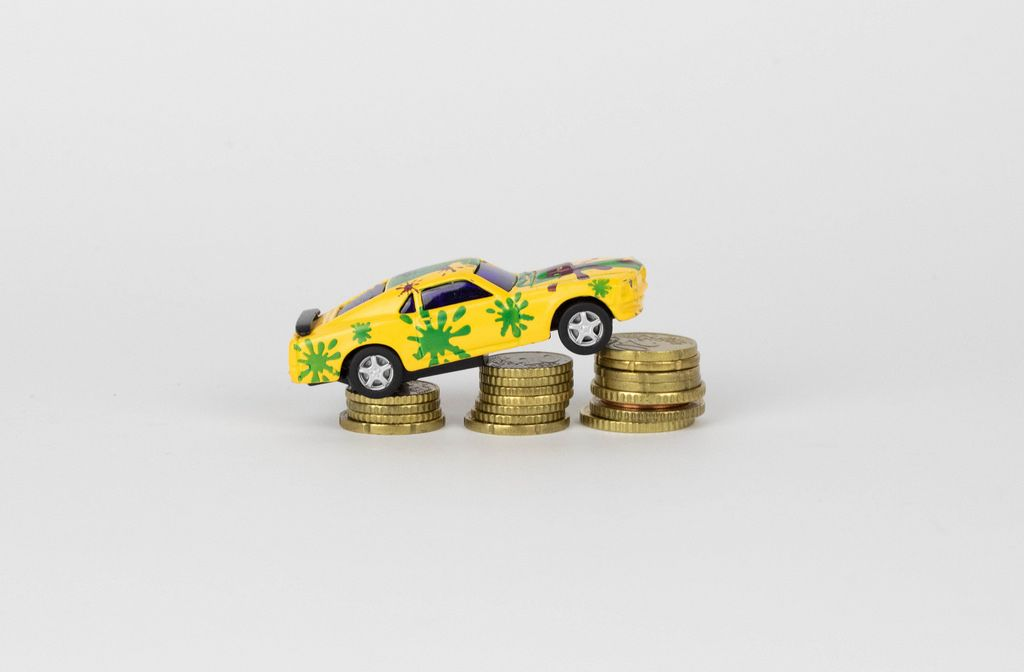 Toy car on coin stack
