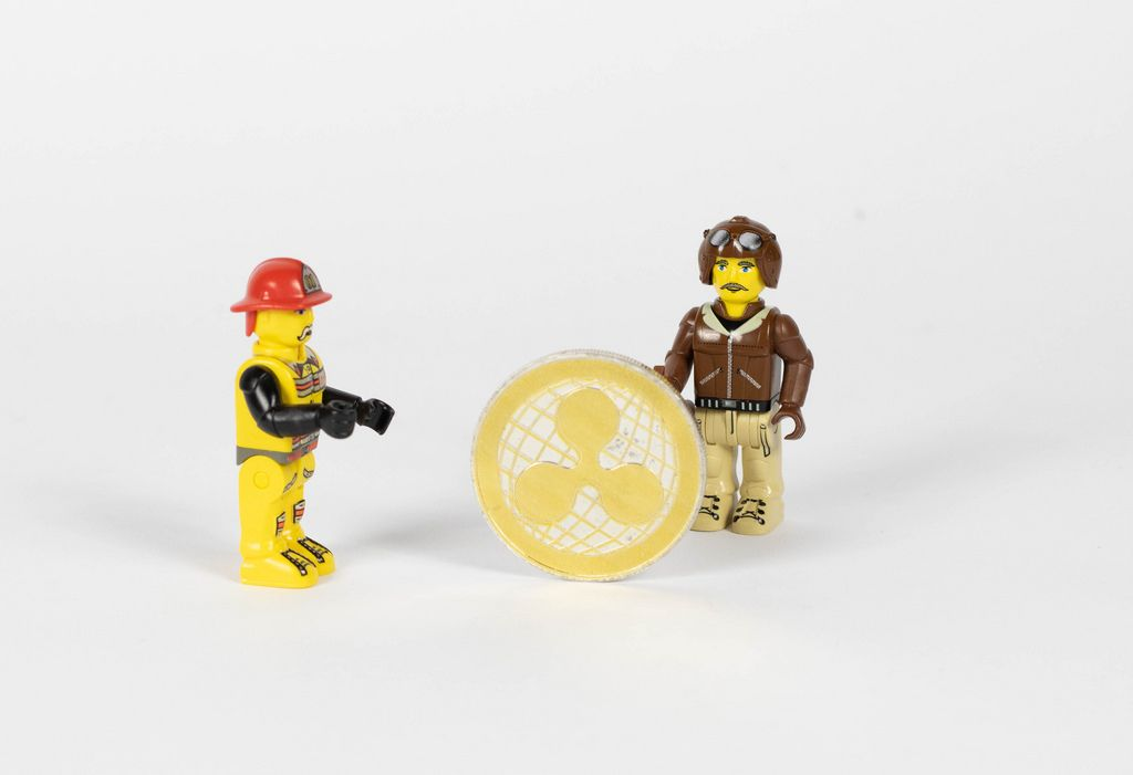Toy figures with Ripple coin
