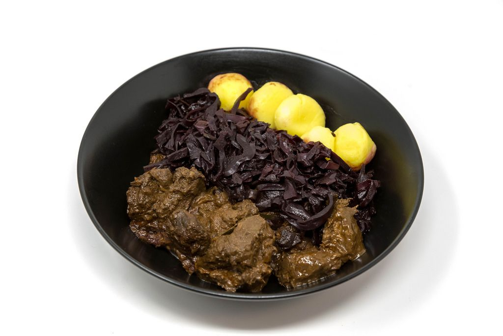 Traditional beef stew with apple beetroot salad and potato dumplings