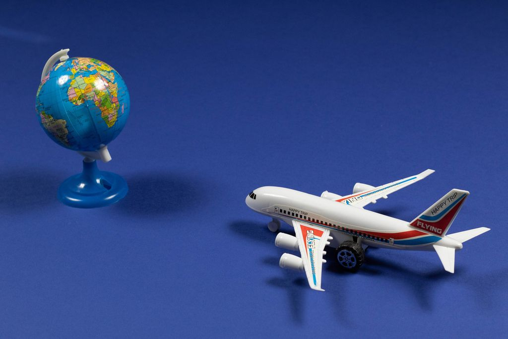 Travel theme with miniature airplane and globe