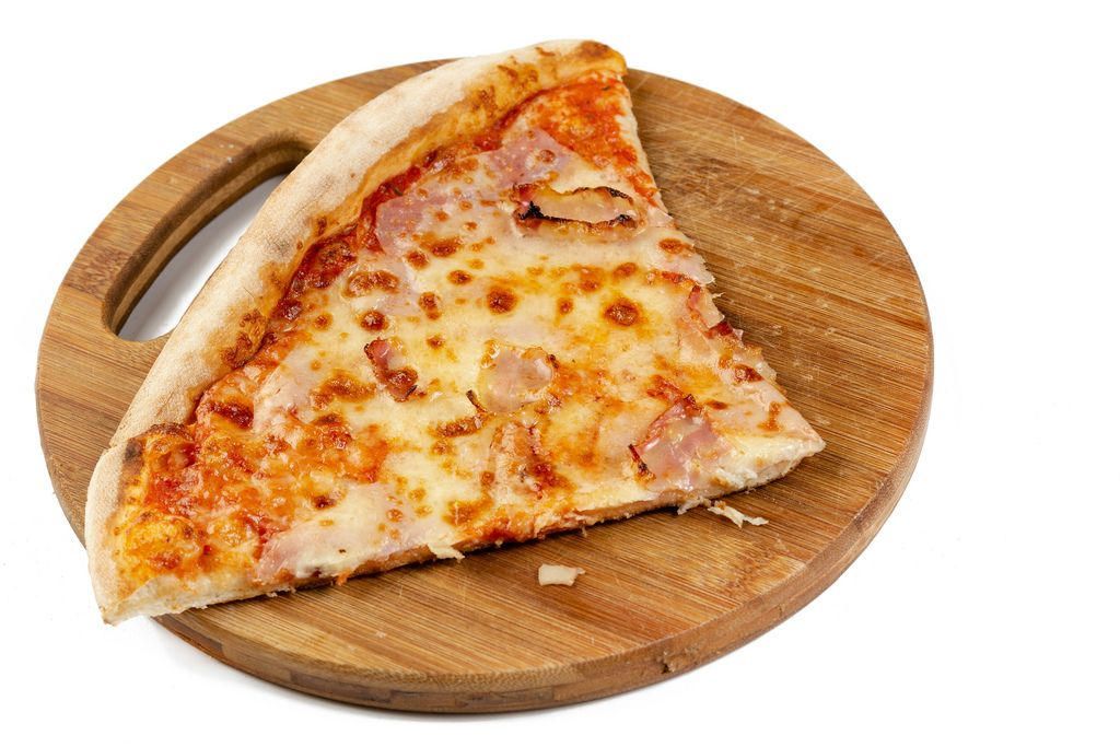 Triangle slice of Fresh Pizza on the wooden board (Flip 2019)