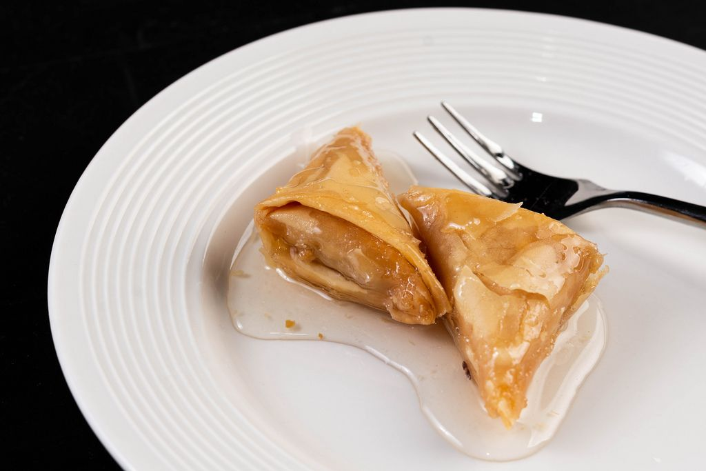 Triangle traditional Baklava cake on the plate