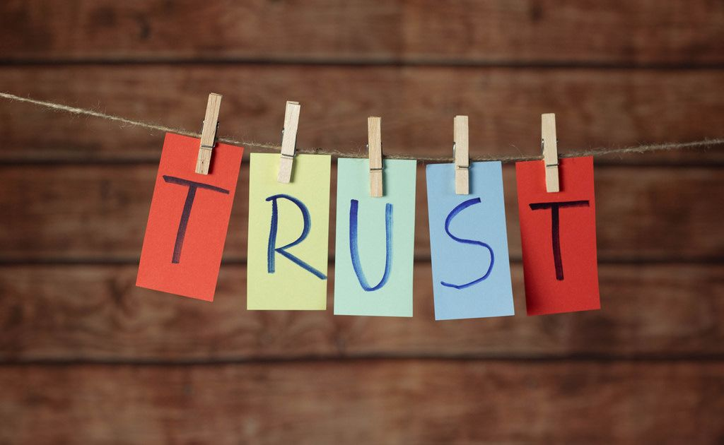 Trust text hanging on the rope