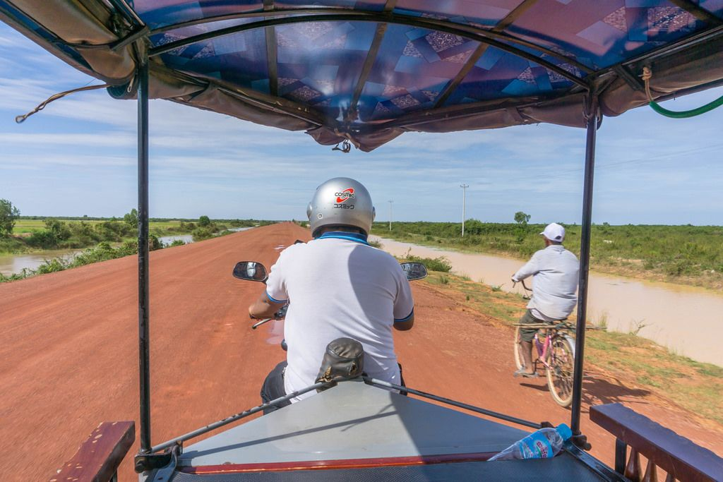 TukTuk overtaking a Man on a Bicycle in Siem Reap