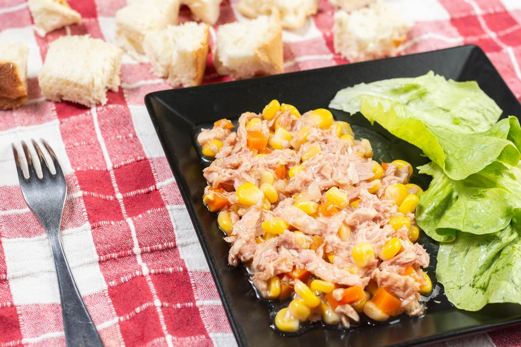 Tuna Fish with Corn and green Salad on the table