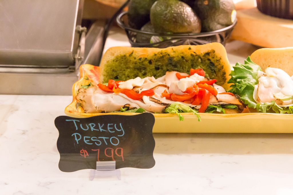 Turkey pesto sandwich: smoked turkey breast, pesto, green salad, pepper and cream cheese