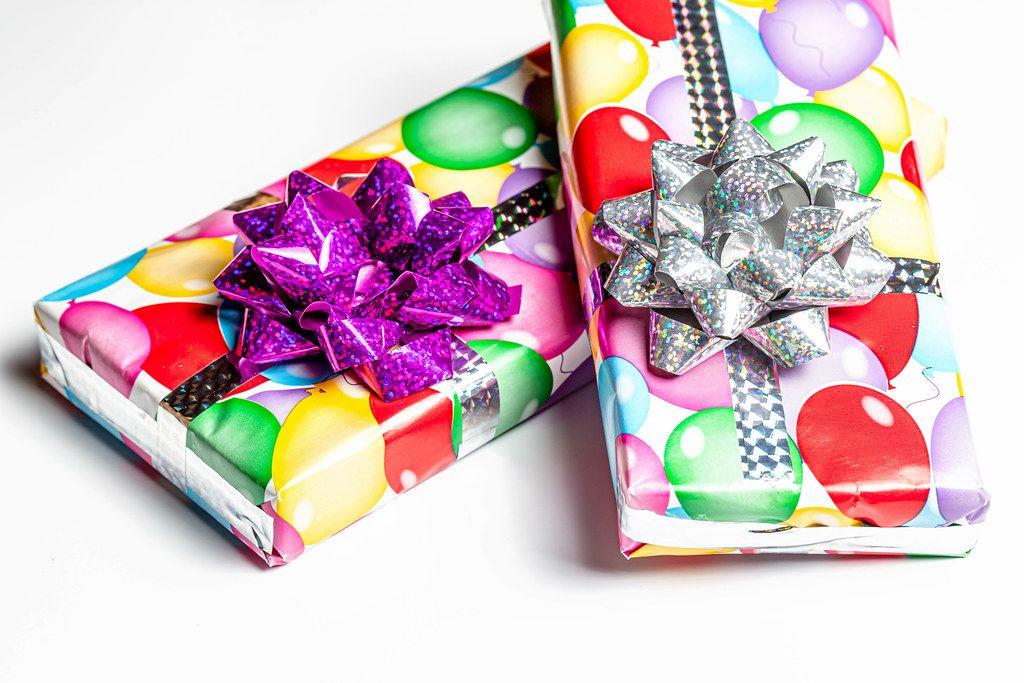 Two birthday gift boxes on white background
