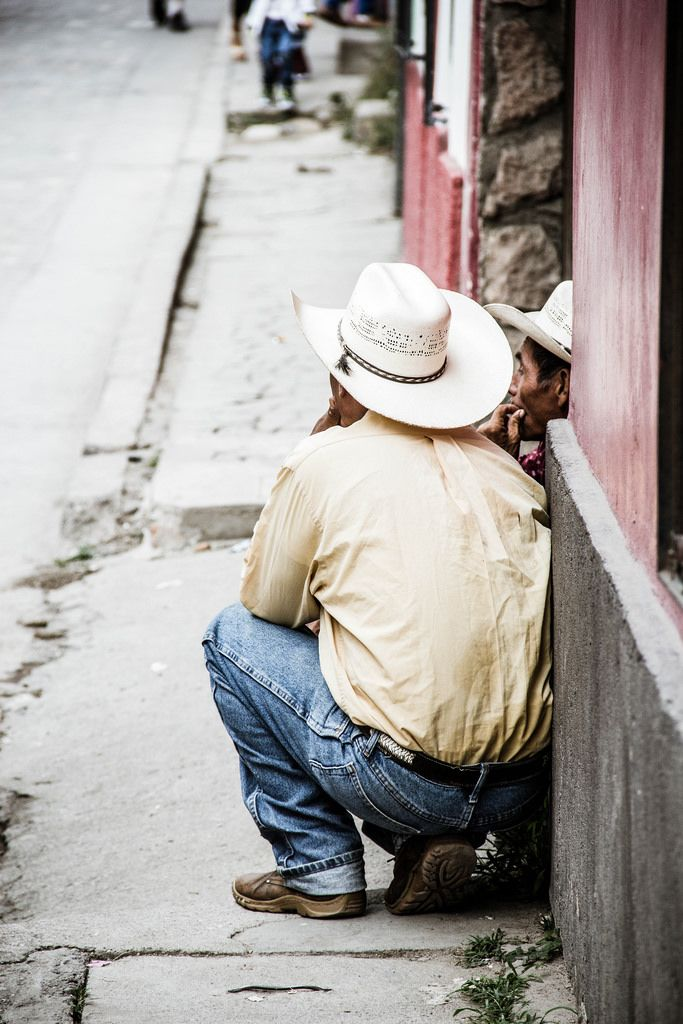 Two Cowboys Talking in the Street