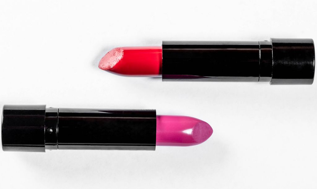 Two lipsticks on a white background. The concept of women's makeup