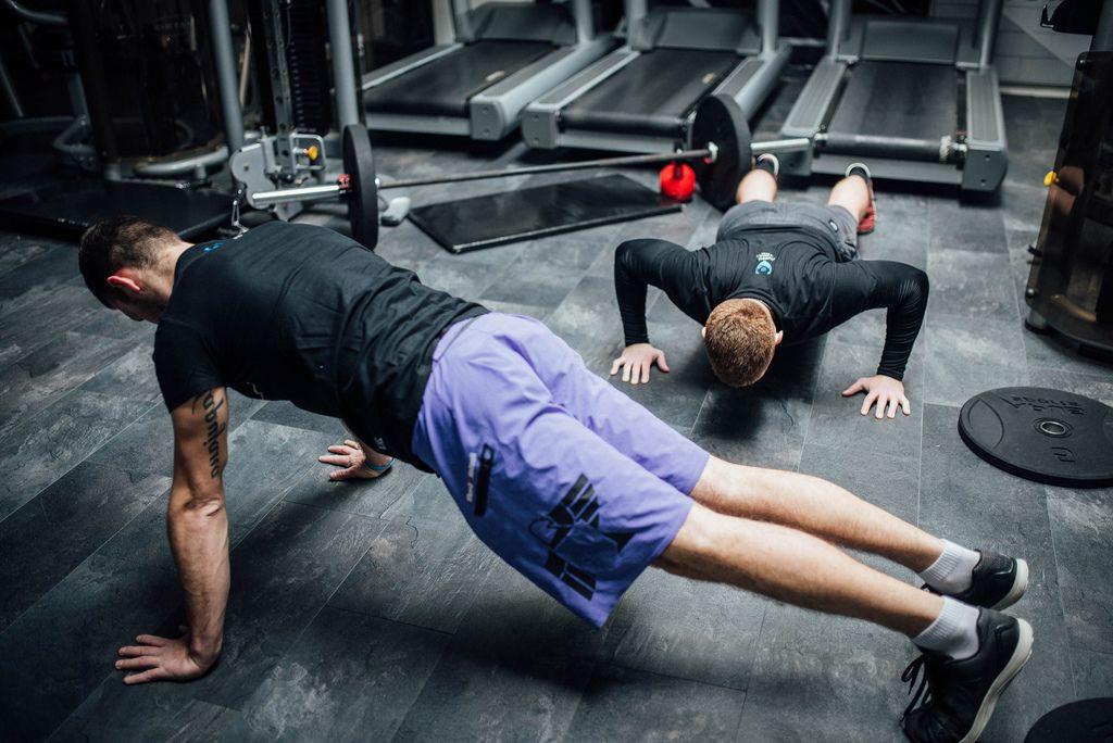 Two men exercising at the gym (Flip 2019) (Flip 2019) Flip 2019