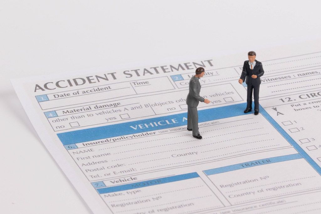 Two men with accident statement report