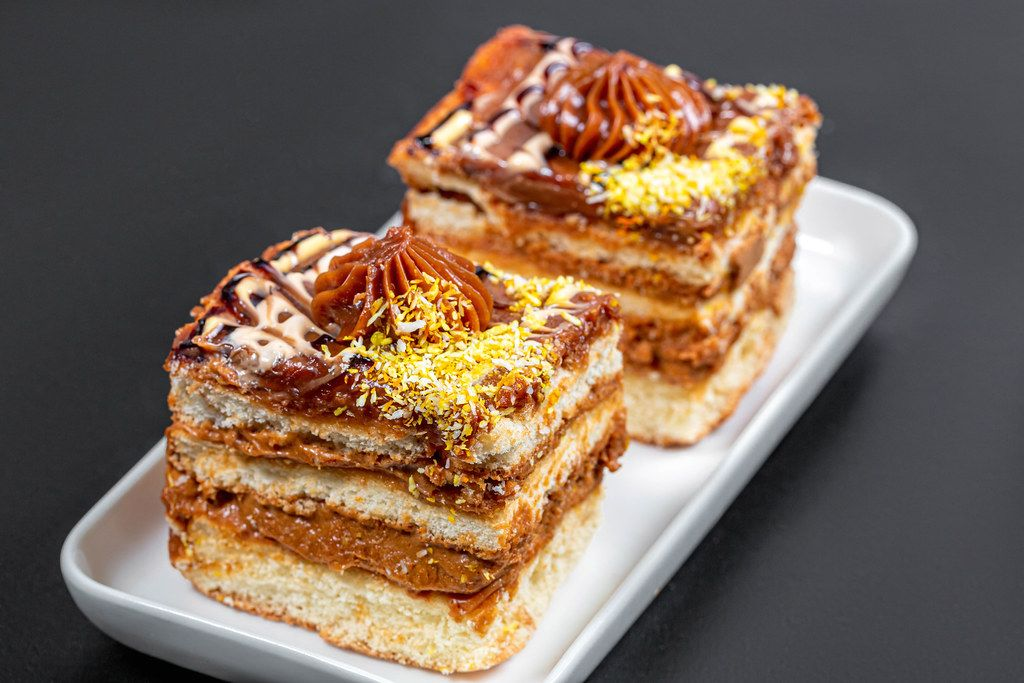 Two pieces of cake with condensed milk and coconut