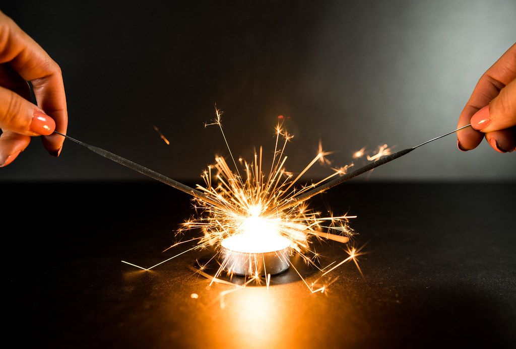 Two sparklers catching on fire