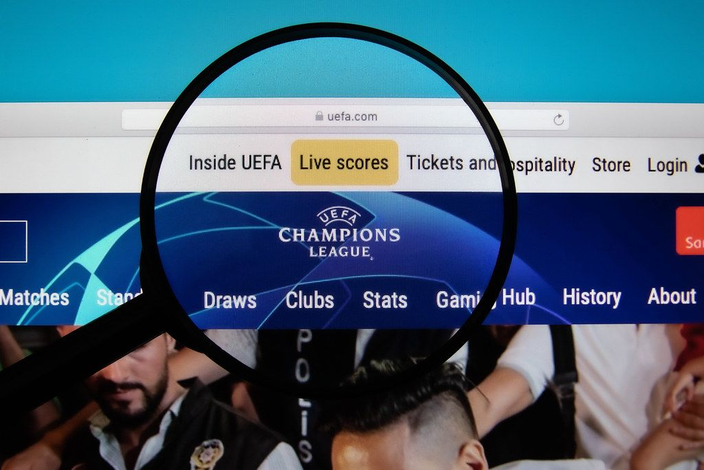 UEFA Champions League logo on a computer screen with a magnifying glass