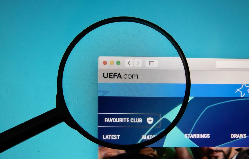 UEFA logo on a computer screen with a magnifying glass