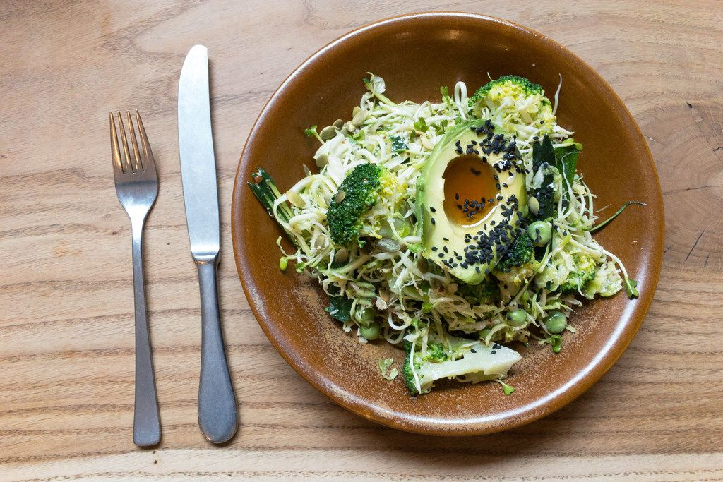 ULTRA GREEN BOWL with shaved brussels sprouts, broccoli, fresh peas, scallions, zucchini, avocado, sesame