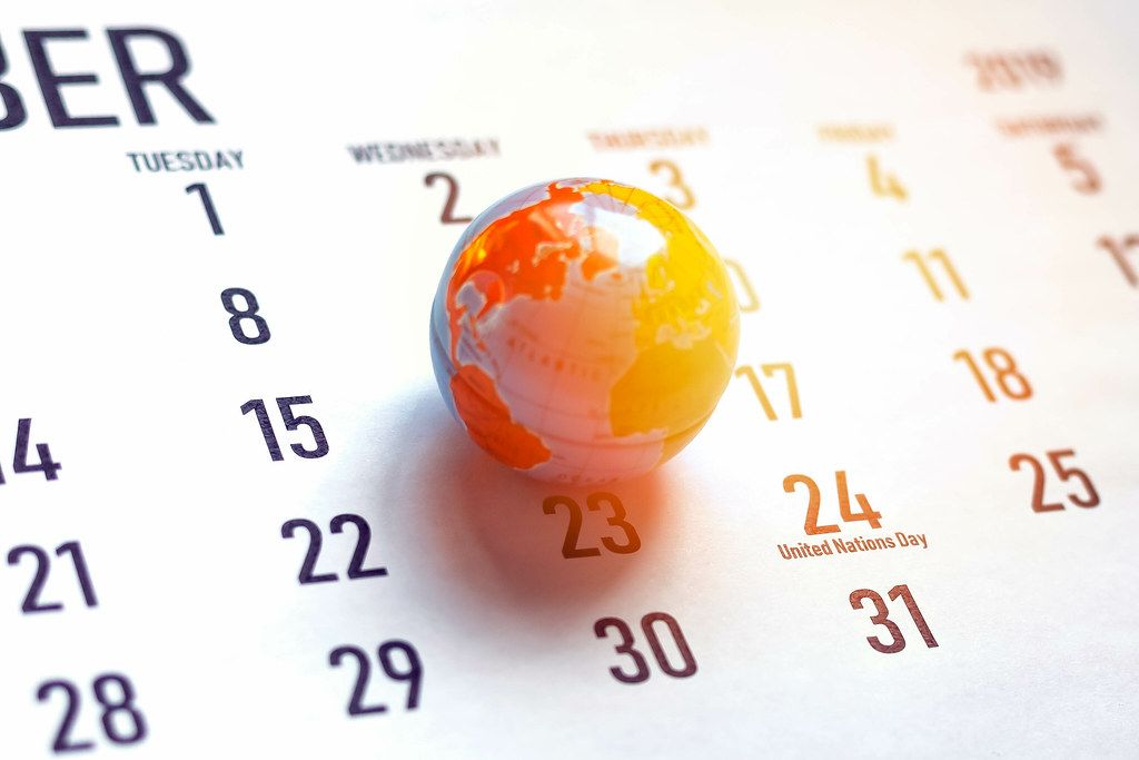 United Nations Day. October calendar and miniature globe of the world. 24th October marked on calendar