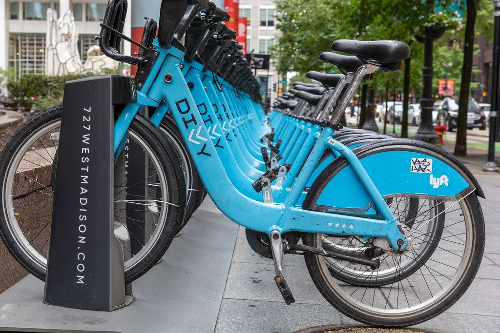 Urban mobility: the blue bikes of the Divvy bike sharing system in Chicago parked at a dock in the city