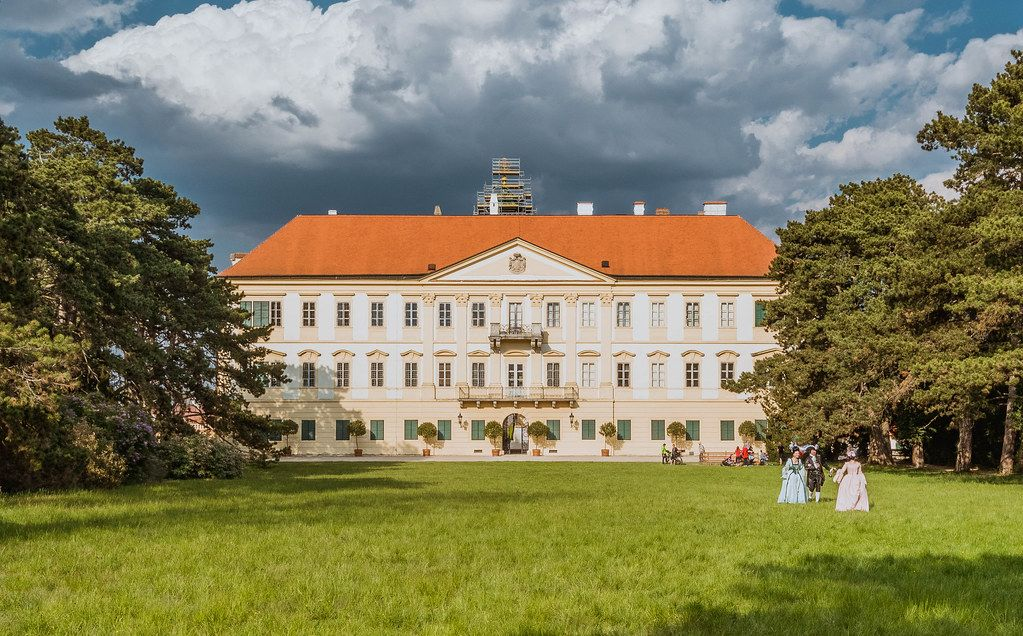 Valtice castle with trees and cloudy sky