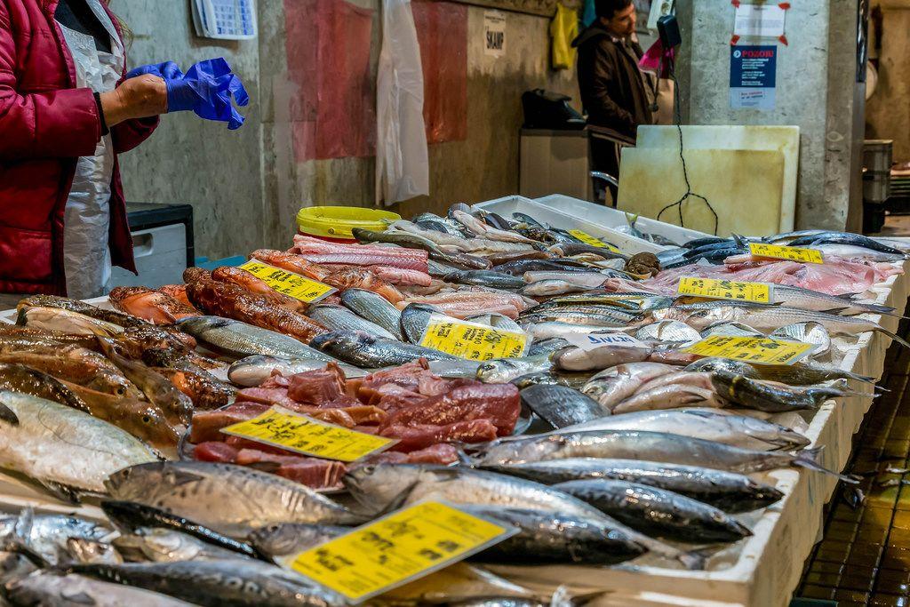 Various fish and fish salesman on fish market in Rijeka, Croatia