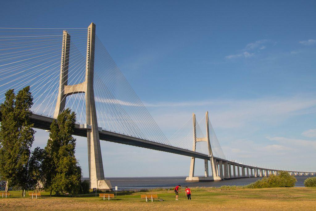 Vasco da Gama Bridge and park with blue sky